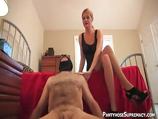 Slender MILF smothering and shoes worshiping domination
