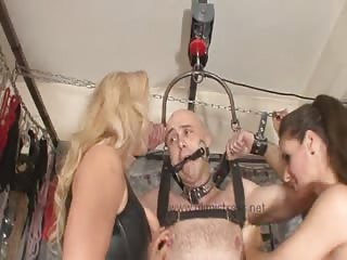 Badly bounded bald man teased by two super hot babes
