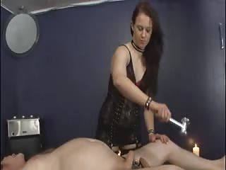 Inflicting pain to his cock and balls