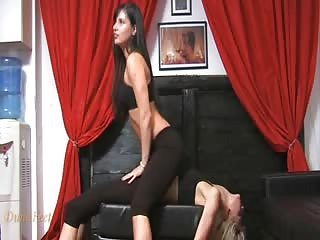 Skinny lesbians having fun on the black couch