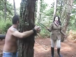 Whipping torture in the forest