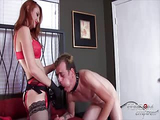 Evil redhead fucks her man with strapon