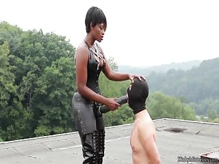 Femdom strapon blow job outdoors