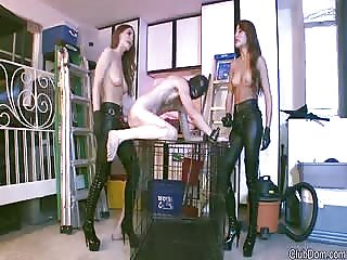 Gorgeous half naked mistresses pegging loser man