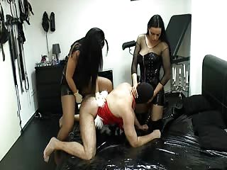 Two mistresses with one strapon male slave
