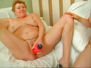 Strapon session of two horny grannies