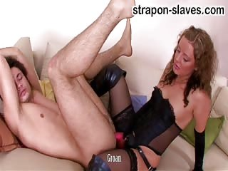 Mean mistress pegging slave on the couch