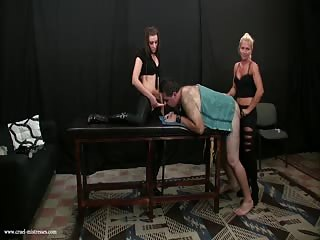 One male slave controlled by two evil mistresses