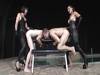 Two strapon male slaves