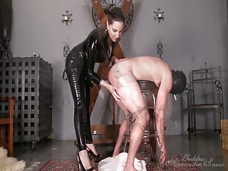 Mistress in black latex pegging slave boy