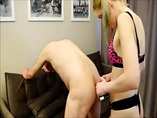Blonde girl with strapon penetrates asshole of sub guy