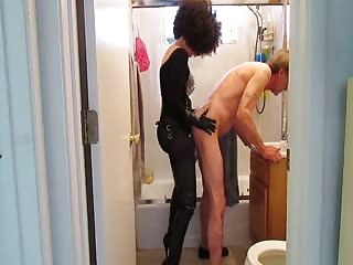 Clothed cougar penetrates her old husband's asshole