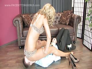 Humiliated under mistress ass