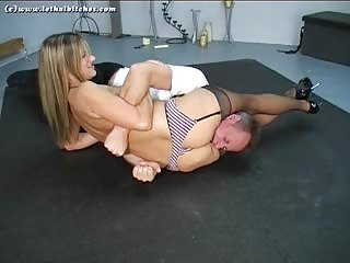 Total domination in mixed wrestling and scissoring